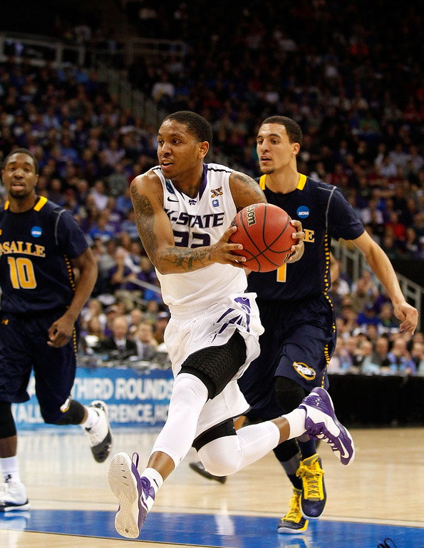 . KANSAS CITY, MO - MARCH 22:  Rodney McGruder #22 of the Kansas State Wildcats drives against the La Salle Explorers in the first half during the second round of the 2013 NCAA Men\'s Basketball Tournament at the Sprint Center on March 22, 2013 in Kansas City, Missouri.  (Photo by Ed Zurga/Getty Images)