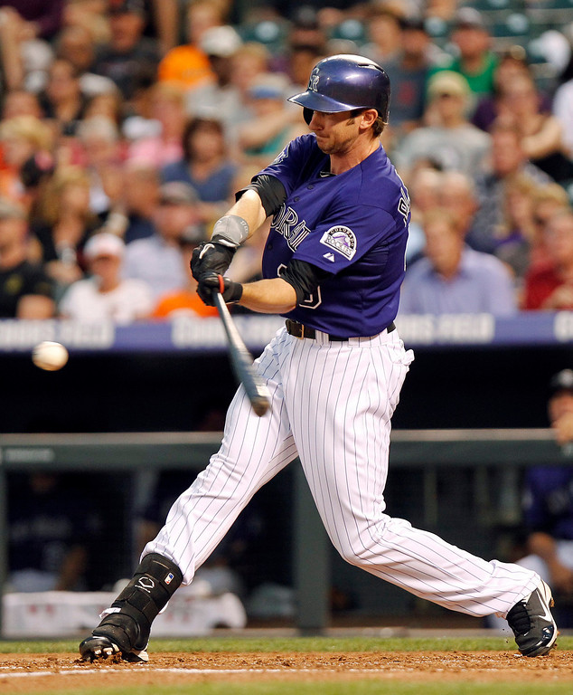. Colorado Rockies\' Charlie Blackmon (19) hits a home run off of San Francisco Giants\' Barry Zito during the third inning of a baseball game, Monday, Aug. 26, 2013, in Denver. (AP Photo/Barry Gutierrez)
