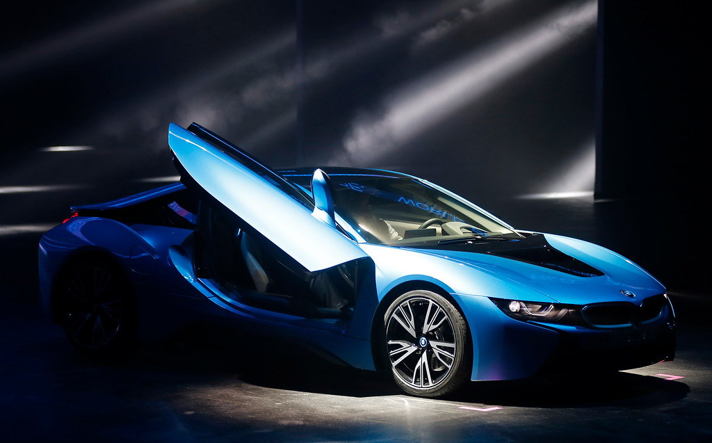. BMW i8 plug-in hybrid sports car is displayed during its premiere at the first press day of the 65th Frankfurt Auto Show in Frankfurt, Germany, Tuesday, Sept. 10, 2013. (AP Photo/Frank Augstein)