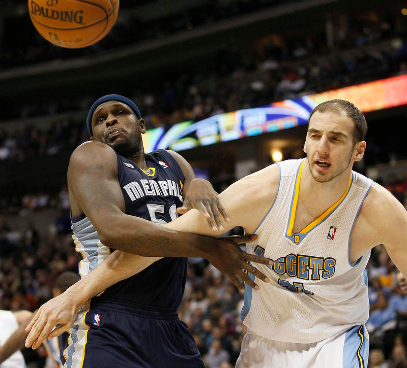 . Memphis Grizzlies forward Zach Randolph (L) and Denver Nuggets center Kosta Koufos chase down a rebound in the second quarter of their NBA basketball game in Denver December 14, 2012. REUTERS/Rick Wilking