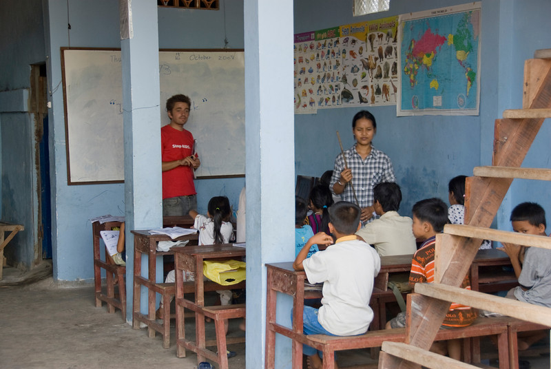 Students listening in to English class session at an orphanage in Phnom Penh