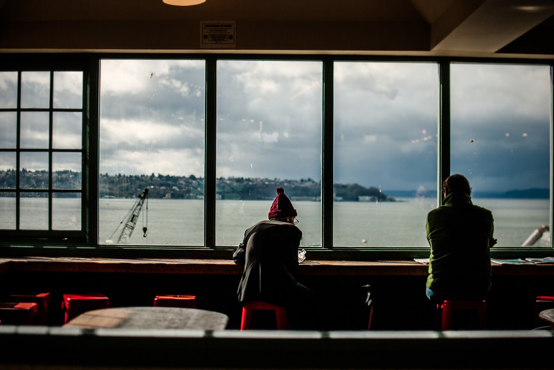 men in window overlooking elliot bay eating lunch.jpg