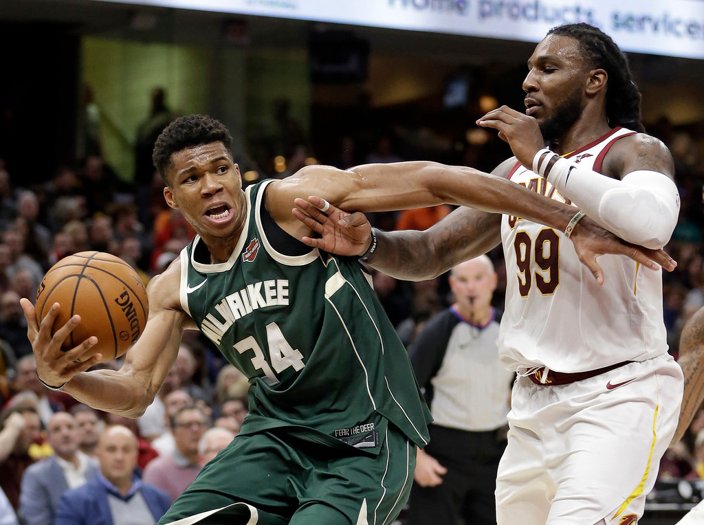 . Milwaukee Bucks\' Giannis Antetokounmpo (34), from Greece, drives against Cleveland Cavaliers\' Jae Crowder (99) in the second half of an NBA basketball game, Tuesday, Nov. 7, 2017, in Cleveland. The Cavaliers won 124-119. (AP Photo/Tony Dejak)