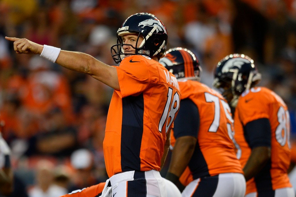 . DENVER, CO - AUGUST 23:  Peyton Manning (18) of the Denver Broncos gestures during a preseason football game at Sports Authority Field at Mile High on Saturday, August 23, 2014 in Denver, Colorado.  (Photo by Kent Nishimura/The Denver Post)