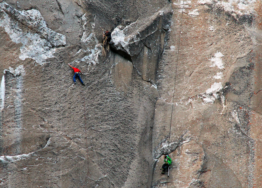 . In this Jan. 8, 2015 photo provided by Tom Evans, Tommy Caldwell, in red, climbs pitch 19 while cameraman Brett Lowell records at lower right and another unidentified cameraman shoots from above during what has been called the hardest rock climb in the world: a free climb of El Capitan, the largest monolith of granite in the world, a half-mile section of exposed granite in California\'s Yosemite National Park. El Capitan rises more than 3,000 feet above the Yosemite Valley floor. The first climber reached its summit in 1958, and there are roughly 100 routes up to the top. (AP Photo/Tom Evans, elcapreport)