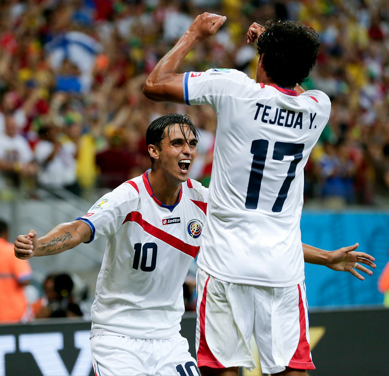 . Costa Rica\'s Bryan Ruiz, right, celebrates with his teammate Yeltsin Tejeda after scoring his side\'s first goal during the World Cup round of 16 soccer match between Costa Rica and Greece at the Arena Pernambuco in Recife, Brazil, Sunday, June 29, 2014. (AP Photo/Petr David Josek)