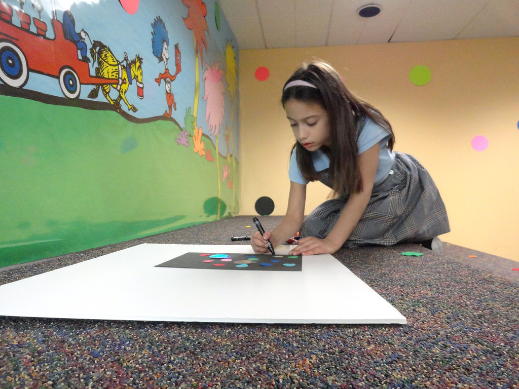. Sarah Thacker decorates the dots in her art. (Courtesy Mentor Public Library)
