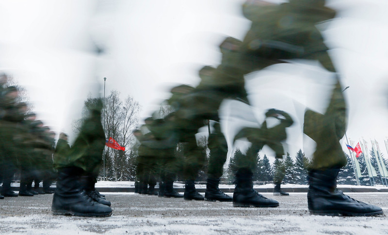 . In this photo taken with long exposure soldiers march during a parade marking the 70th anniversary of the battle that lifted the Siege of Leningrad in St.Petersburg, Russia, Monday, Jan. 27, 2014. The Nazi German and Finnish siege and blockade of Leningrad, now known as St. Petersburg, was broken on Jan. 18, 1943 but finally lifted Jan. 27, 1944. More than 1 million people died mainly from starvation during the 900-day siege. (AP Photo/Dmitry Lovetsky)