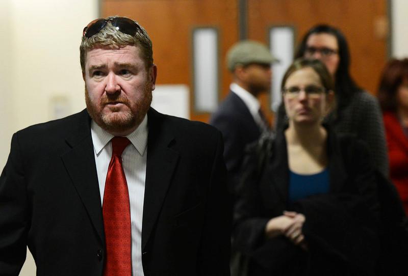 . Daniel King, of the defense team arrive for court, Monday, January 7, 2013, in Centennial. RJ Sangosti, The Denver Post