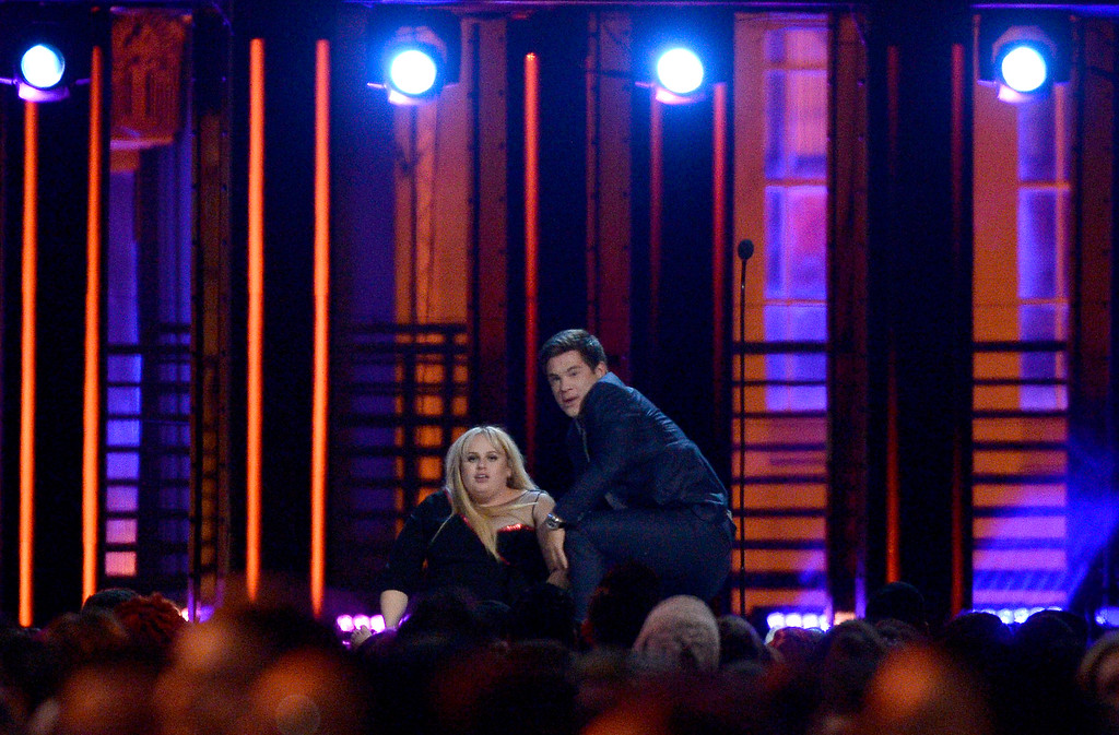 . Adam DeVine, right, and Rebel Wilson, winners of the award for best kiss for �Pitch Perfect 2,� are seen after rolling on the floor as they kiss at the MTV Movie Awards at Warner Bros. Studio on Saturday, April 9, 2016, in Burbank, Calif. (Kevork Djansezian/Pool Photo via AP)