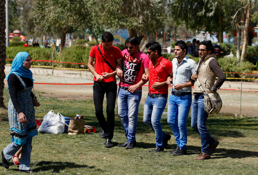 ". Iraqis dance during the Nowruz festival at Zawraa Park in Baghdad, Iraq, Thursday, March 21, 2013. Nowruz, the Farsi-language word for ""new year\"", is an ancient Persian festival, celebrated on the first day of spring in countries including Iraq, Turkey, Afghanistan and Iran. The festival is a symbolic opportunity to purify the soul for the new year and symbolizes revival and is marked by spring cleaning, buying new clothes and planting trees. (AP Photo/Karim Kadim)"