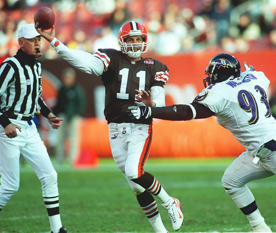 . News-Herald file Cleveland back up quarterback Ty Detmer is pressured out of the pocket by Baltimore\'s Keith Washington during second half action of Sundays game at Cleveland Browns Stadium.