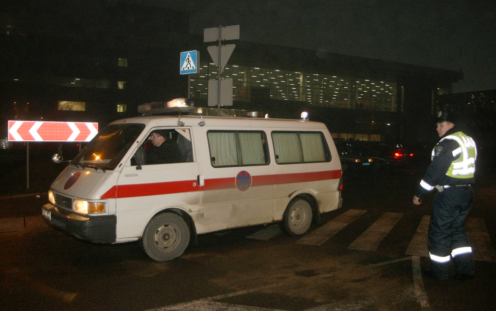 Description of . An ambulance car leaves the Donetsk International Airport on February 13, 2013 after an Antonov AN-24 plane with dozens of football fans on board made an emergency landing in the eastern Ukraine city of Donetsk .