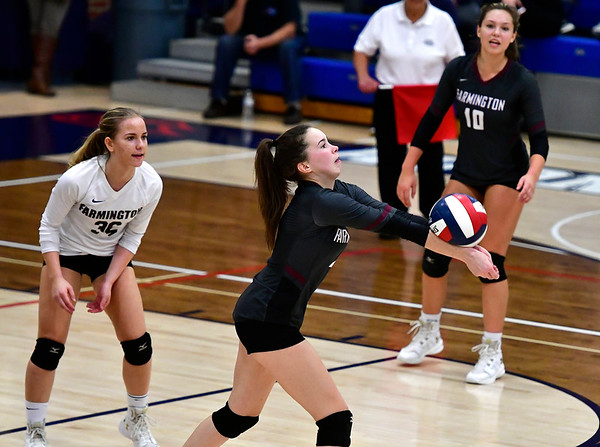 11/1/2018 Mike Orazzi | Staff Farmington High Schools Carolyn Piera (36), Katherine Siuta (2) and Holly Picchioni (10) during the CCC Volleyball Tournament held at Avon High School Thursday night.