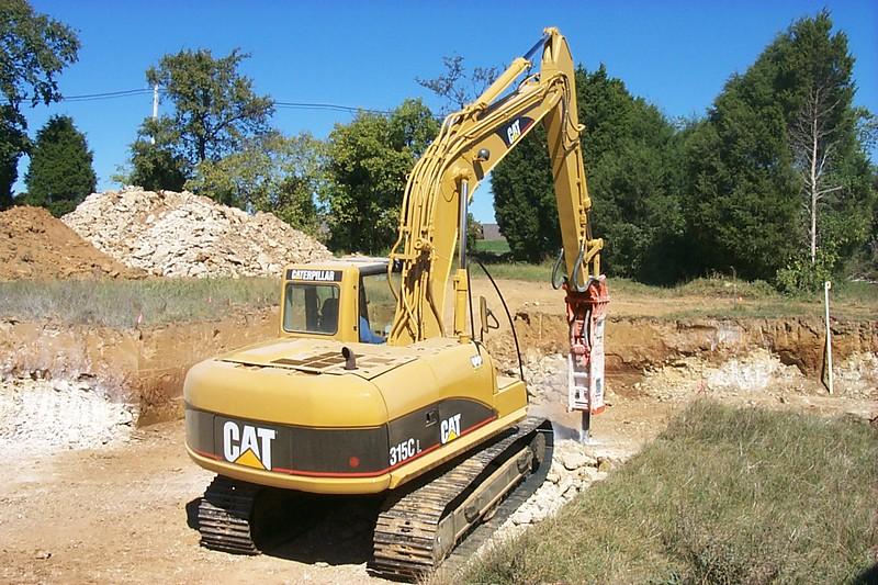 NPK E208 hydraulic hammer on Cat excavator (1).jpg