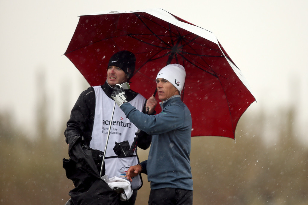 . MARANA, AZ - FEBRUARY 20:  Thorbjorn Olesen (R) of Denmark stands with his caddie under an umbrella to avoid the snow and rain during the first round of the World Golf Championships - Accenture Match Play at the Golf Club at Dove Mountain on February 20, 2013 in Marana, Arizona.  (Photo by Darren Carroll/Getty Images)