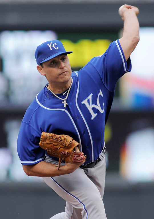 . Kansas City Royals pitcher Jason Vargas throws against the Minnesota Twins during the first inning. (AP Photo/Tom Olmscheid)