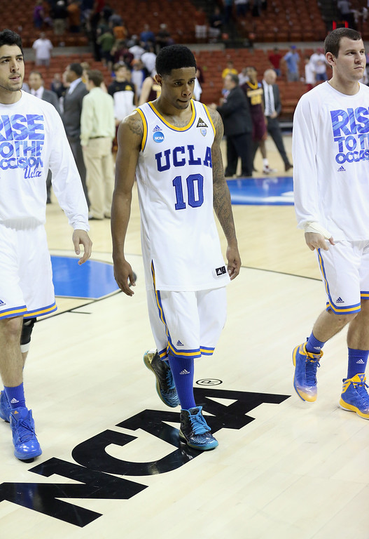 . AUSTIN, TX - MARCH 22:  Larry Drew II #10 of the UCLA Bruins walks off the court after his teams loss against the Minnesota Golden Gophers during the second round of the 2013 NCAA Men\'s Basketball Tournament at The Frank Erwin Center on March 22, 2013 in Austin, Texas.  (Photo by Stephen Dunn/Getty Images)