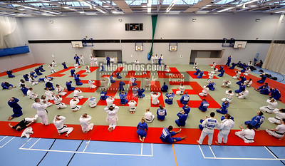 2013 Tonbridge Judo Training Camp 131220A5528: Under the guidance of Chris Bowles the judoka stretch and relax after the morning randori session d....