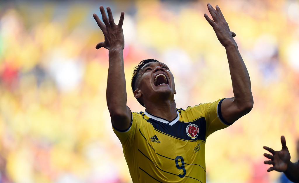 . Colombia\'s forward Teofilo Gutierrez celebrates after scoring during a Group C football match between Colombia and Greece at the Mineirao Arena in Belo Horizonte during the 2014 FIFA World Cup on June 14, 2014.   AFP PHOTO / EITAN ABRAMOVICH