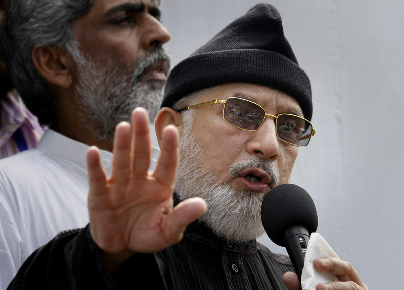. Anti-government Muslim cleric Tahir-ul-Qadri delivers a speech during a protest near Prime Minister\'s home in Islamabad, Pakistan on Monday, Sept. 1, 2014. Anti-government protesters and Pakistani police have clashed once again as the demonstrators pushed into a sprawling government complex in the country\'s capital in an effort to try to reach the prime minister\'s official residence. (AP Photo/Anjum Naveed)