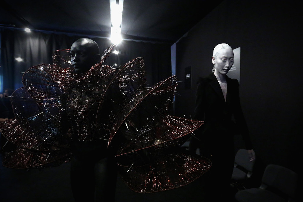 . Models prepare backstage ahead of Hu Sheguang Haute Couture Collection show during Mercedes-Benz China Fashion Week Spring/Summer 2014 at 751 D-PARK Workshop on October 29, 2013 in Beijing, China.  (Photo by Feng Li/Getty Images)