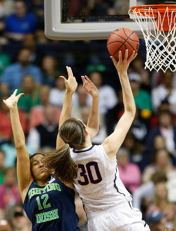 . Connecticut forward Breanna Stewart (30) shoots against Notre Dame forward Taya Reimer (12) during the first half of the championship game in the Final Four of the NCAA women\'s college basketball tournament, Tuesday, April 8, 2014, in Nashville, Tenn. (AP Photo/John Bazemore)
