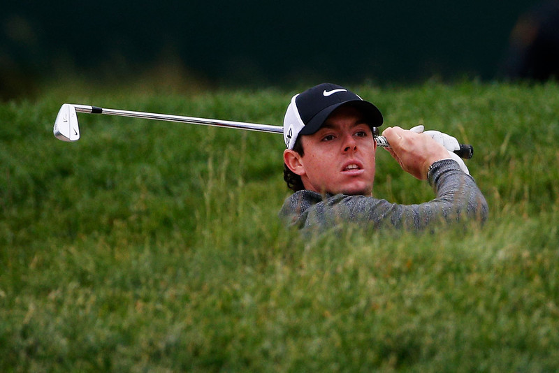 . Rory McIlroy of Northern Ireland hits from a bunker on the 15th hole during a continuation of Round One of the 113th U.S. Open at Merion Golf Club on June 14, 2013 in Ardmore, Pennsylvania.  (Photo by Rob Carr/Getty Images)