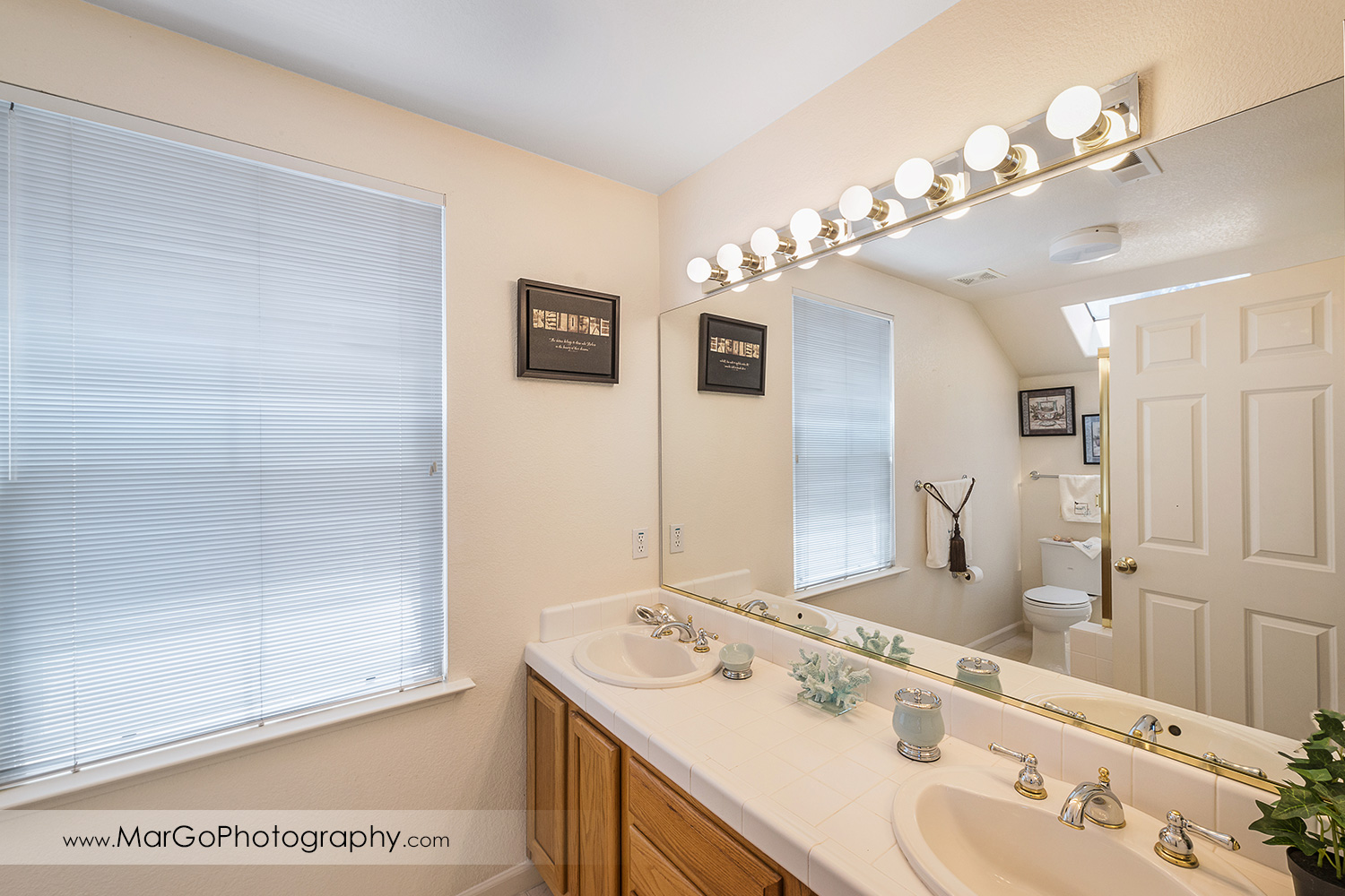 San Francisco house white bathroom with two sinks and big mirror - real estate photography