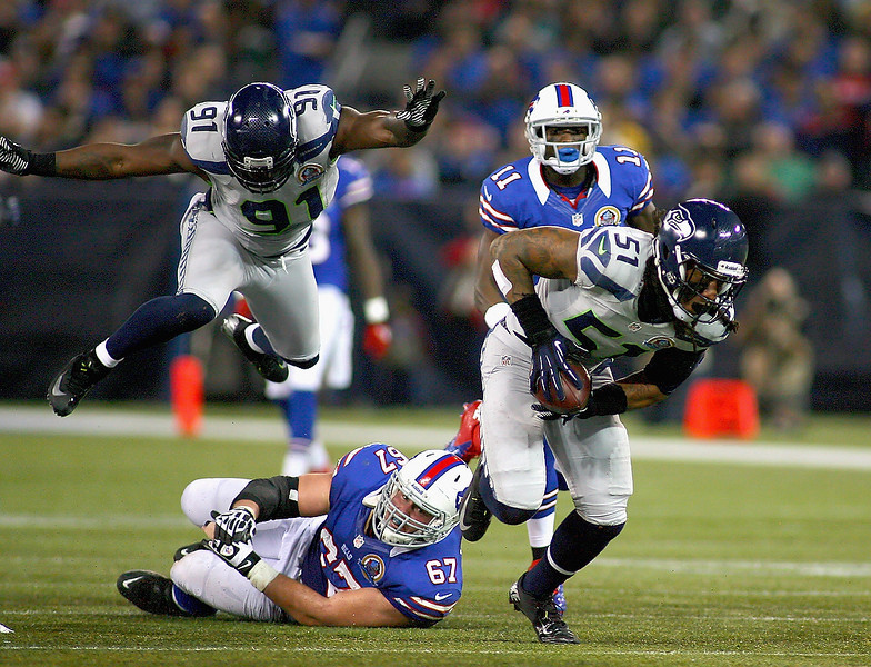 . Bruce Irvin #51 of the Seattle Seahawks picks up a fumble against the Buffalo Bills at Rogers Centre on December 16, 2012 in Toronto, Ontario, Canada. Seattle won 50-17.  (Photo by Rick Stewart/Getty Images)