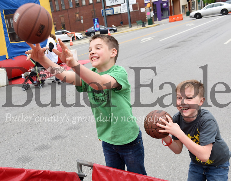 Harold Aughton/Butler Eagle: Brothers Trevor, 9, and Brayden, 7, Geibel of Butler shoot a round of hoopes Saturday afternoon at the Butler County Recovery and Resource Block Party.