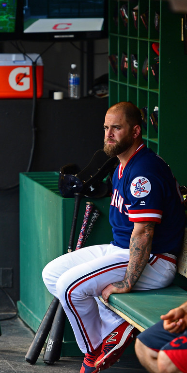 . Cleveland Indians\' Mike Napoli sits in the dugout during a rain delay during a baseball game against the Kansas City Royals, Saturday, June 4, 2016, in Cleveland. (AP Photo/David Dermer)
