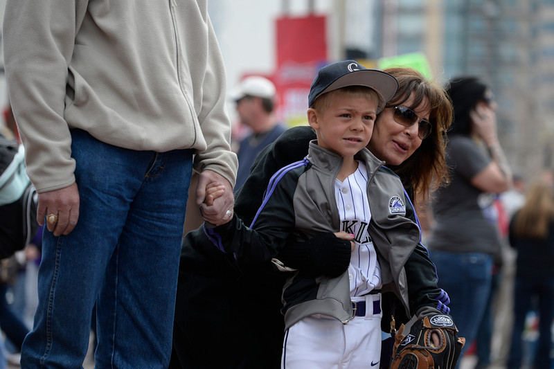 . Wyatt Gustafson, 6, heads into the stadium with his grandparents Mark and Jerri Gustafson of Windsor, Colorado. The Colorado Rockies hosted the Arizona Diamondbacks in the Rockies season home opener at Coors Field in Denver, Colorado Friday, April 4, 2014. (Photo by Craig F. Walker/The Denver Post)