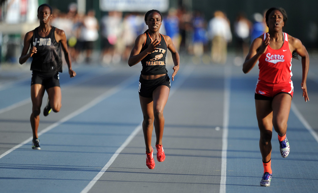 . South Pasadena\'s Laura Anuakpado in the 400 meter dash during the CIF-SS Masters Meet at Cerritos College on Friday, May 24, 2013 in Norwalk, Calif.  (Keith Birmingham Pasadena Star-News)