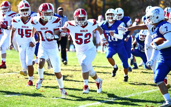 10/19/2019 Mike Orazzi | StaffrBerlin football's Joseph Caracoglia (10) and Jacob Sparks (52) pursue Lewis Mills' Cade Cormier (7) in Burlington on Saturday.