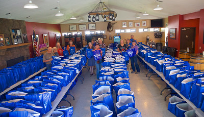 Rodeo Volunteers Stuffing Contestant's Goody Bags 6--3-2019