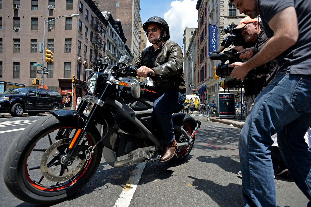 . Harley-Davidson chief marketing officer Mark-Hans Richer takes a Project LiveWire, the company\'s first electric motorcycle, for a ride during a preview June 23, 2014 outside a Harley-Davidson dealer in New York. AFP PHOTO/Stan  HONDA/AFP/Getty Images