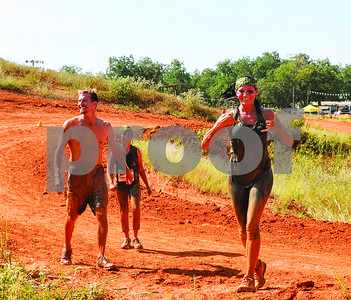 runners-hit-the-mud-during-5k-obstacle-race