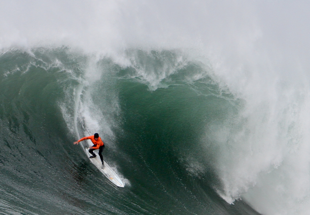 """. Grant \""""Twiggy\"""" Baker navigates the face of an intimidating wave amidst a large swell during final heat of the Mavericks Invitational surf competition in Half Moon Bay on Friday. (Kevin Johnson/Sentinel)"""
