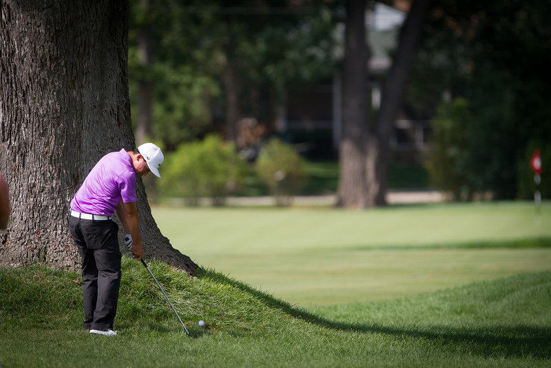 Lorens Chan hits his approach shot to the 9th green during the final round round of medal play at the 2012 Western Amateur Championship at Exmoor Country Club in Highland Park IL. on Thursday, August 2, 2012.. (WGA Photo/Charles Cherney)