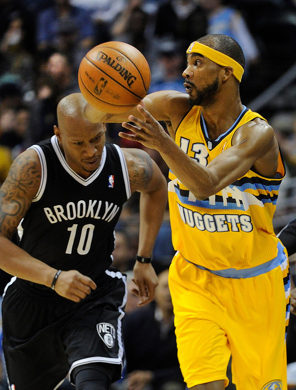 . DENVER, CO. - MARCH 29: Corey Brewer (13) of the Denver Nuggets moved the ball ahead of Keith Bogans (10) of the Brooklyn Nets in the first half. The Denver Nuggets hosted the Brooklyn Nets Friday night, March 29, 2013 at the Pepsi Center in Denver.  (Photo By Karl Gehring/The Denver Post)