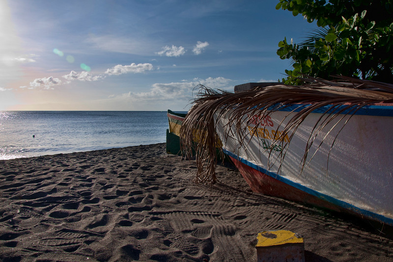 Another stop on a beach..  This colorful boat is covered with palm fronds.