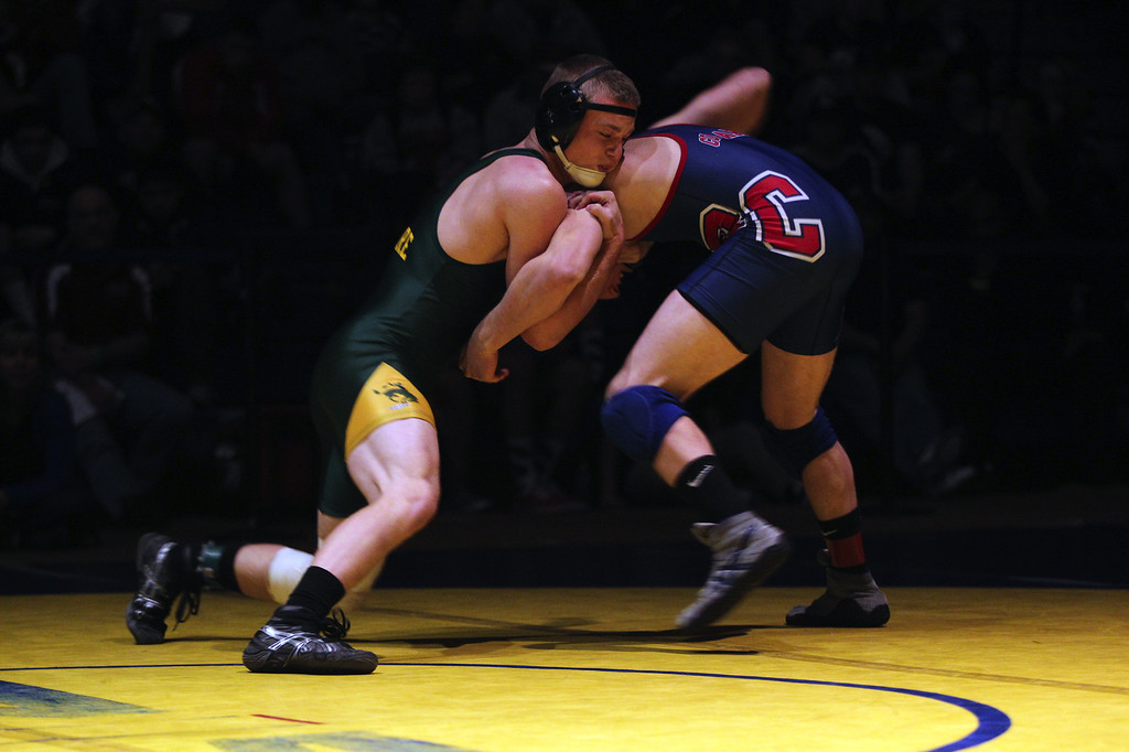 . Livermore\'s Tyler Rardon, left, wrestles Rancho Cotate\'s Joey Clay in the 152-pound finals at the North Coast Section wrestling championships held at Newark Memorial High School in Newark, Calif., on Saturday, Feb. 23, 2013. Rardon would get the win. (Anda Chu/Staff)