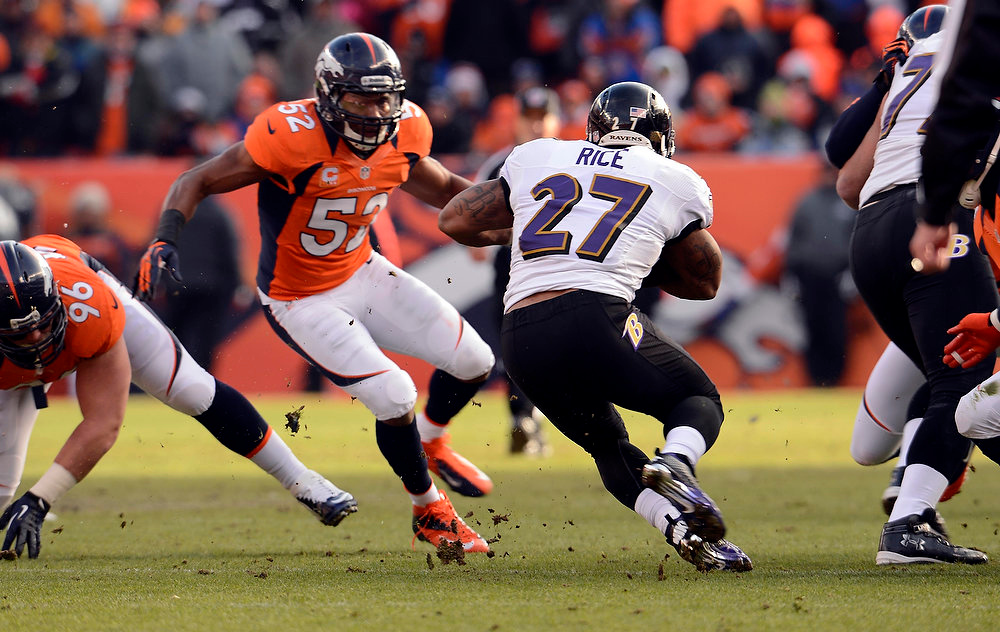 Description of . Baltimore Ravens running back Ray Rice (27) is stopped by Denver Broncos outside linebacker Wesley Woodyard (52) during the first quarter.  The Denver Broncos vs Baltimore Ravens AFC Divisional playoff game at Sports Authority Field Saturday January 12, 2013. (Photo by John Leyba,/The Denver Post)