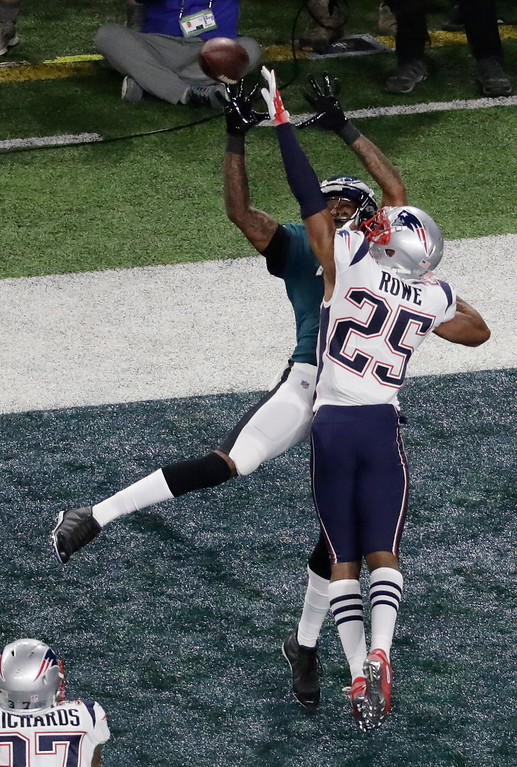 . New England Patriots cornerback Eric Rowe, right, breaks up a pass intended for Philadelphia Eagles wide receiver Alshon Jeffery during the first half of the NFL Super Bowl 52 football game Sunday, Feb. 4, 2018, in Minneapolis. (AP Photo/Eric Gay)