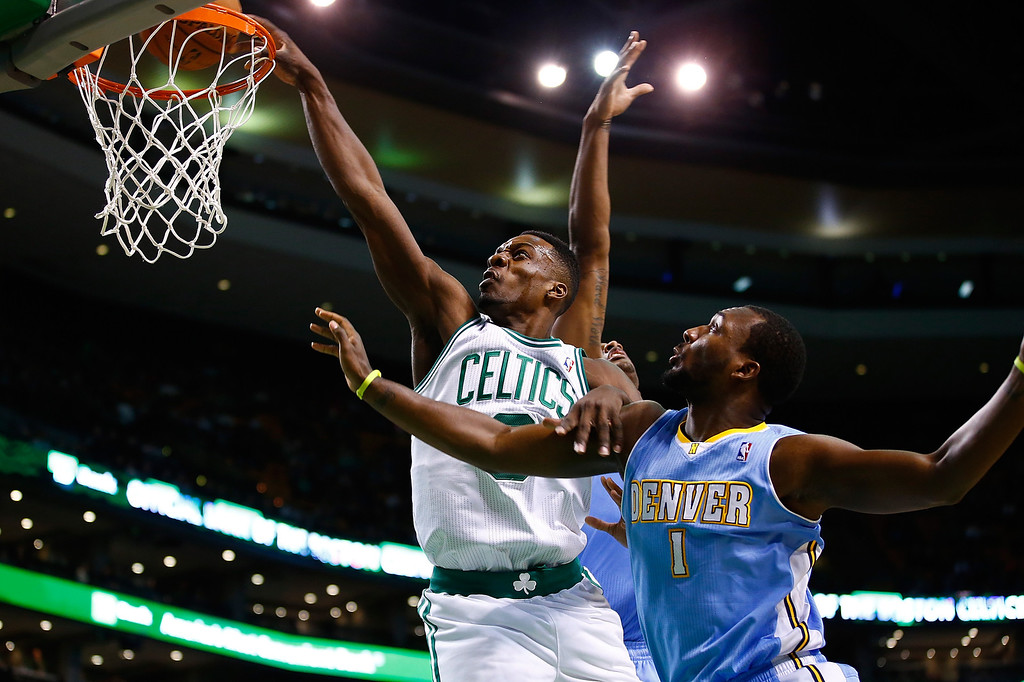 . BOSTON, MA - DECEMBER 06:  Jeff Green #8 of the Boston Celtics attempts a dunk in front of Jordan Hamilton #1 of the Denver Nuggets in the first quarter during the game at TD Garden on December 6, 2013 in Boston, Massachusetts.  (Photo by Jared Wickerham/Getty Images)