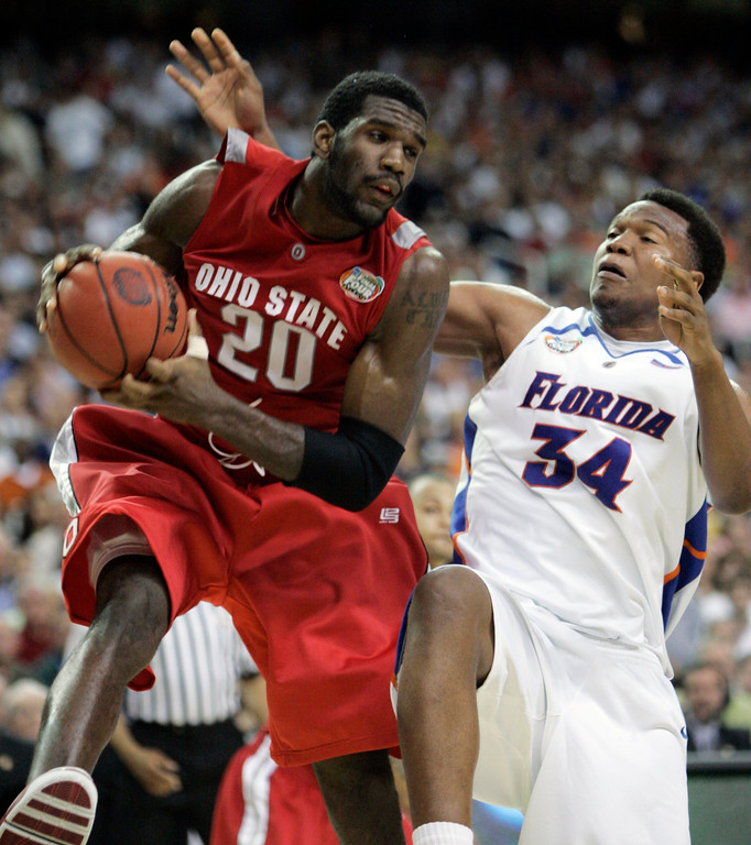 . Ohio State center Greg Oden (20) looks to pass against Florida\'s Marreese Speights (34) in the second half during their men\'s championship basketball game at the Final Four in the Georgia Dome in Atlanta Monday, April 2, 2007. (AP Photo/Mark Humphrey)