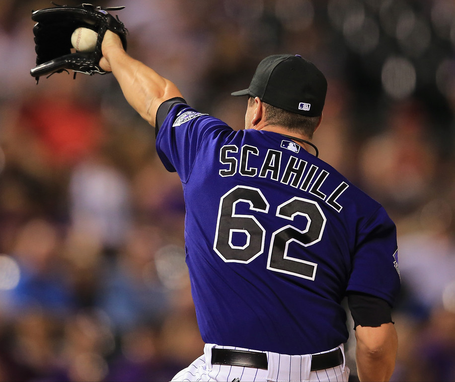 . Relief pitcher Rob Scahill #62 of the Colorado Rockies catches a line drive by Denard Span #2 of the Washington Nationals for the second out of the ninth inning at Coors Field on June 11, 2013 in Denver, Colorado. The Rockies defeated the Nationals 8-3.  (Photo by Doug Pensinger/Getty Images)
