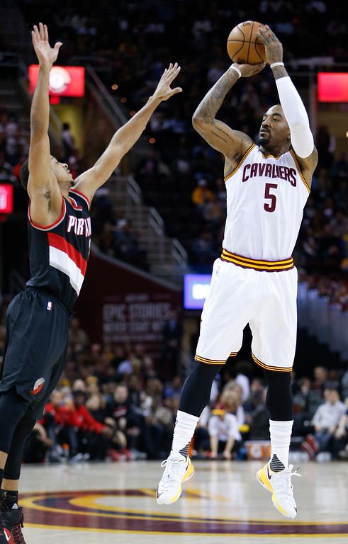 . Cleveland Cavaliers\' J.R. Smith (5) shoots over Portland Trail Blazers\' C.J. McCollum (3) during the first half of an NBA basketball game Wednesday, Nov. 23, 2016, in Cleveland. The Cavaliers won 137-125. (AP Photo/Ron Schwane)