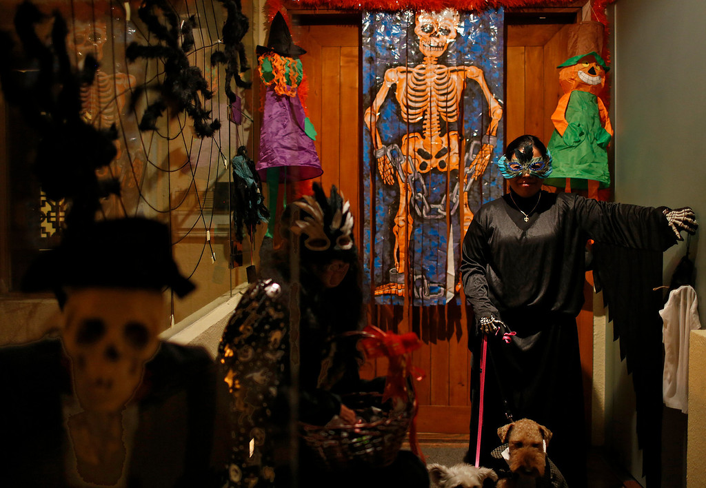 . Two women dressed in Halloween costumes next to decorations on Halloween night in Hong Kong, Thursday, Oct. 31, 2013. (AP Photo/Vincent Yu)